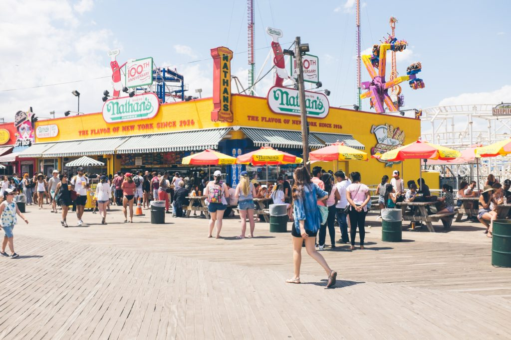 photo of Nathan's famous hot dogs on Coney Island Boardwalk cull of people
